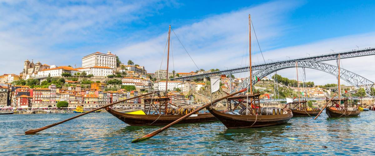 Porto and old  traditional boats with wine barrels in Portugal in a summer day