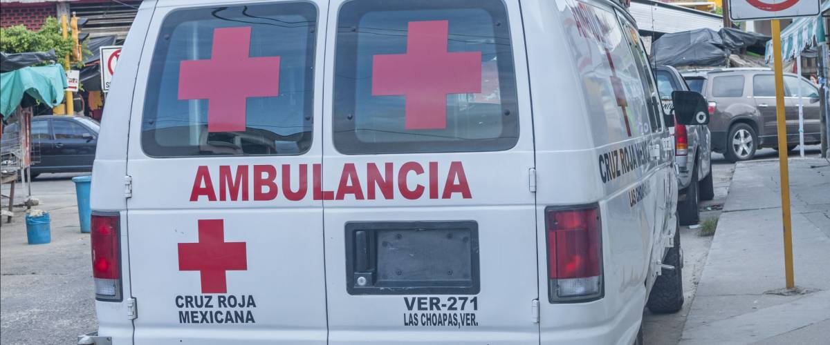LAS CHOAPAS, MEXICO - JULY 12, 2014: A Mexican Red Cross ambulance is parked on downtown street in Las Choapas, Veracruz.  La Cruz Roja is part of the International Red Cross.