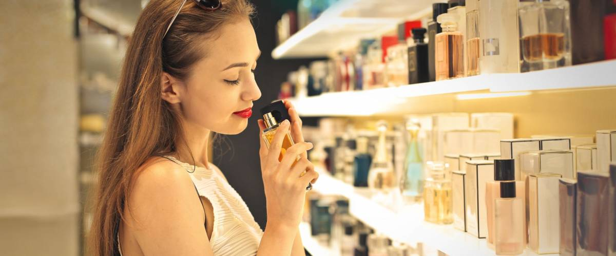 Young woman choosing a perfume