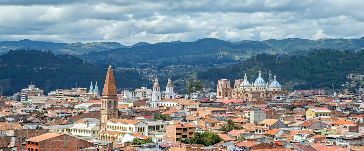 View of the city of Cuenca, Ecuador, with it's many churches, on a cloudy day.