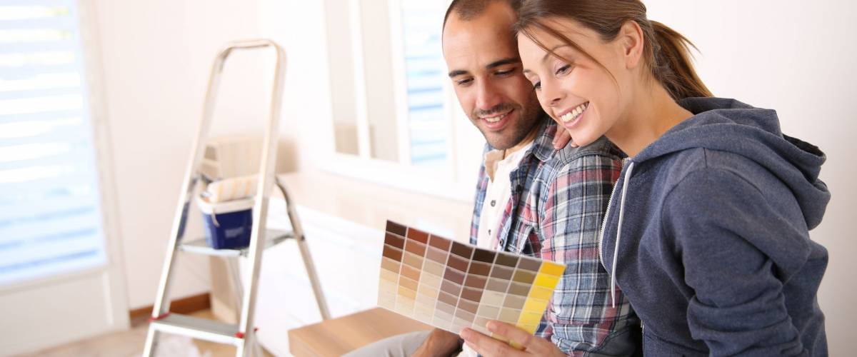Couple in new house choosing color for walls