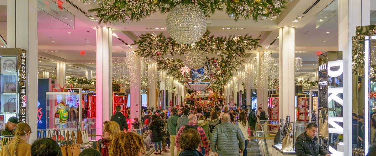 NEW YORK CITY - NOV. 25. 2017: Shoppers filling the beautifully Christmas decorated Macy's Herald Square store  on Black Friday