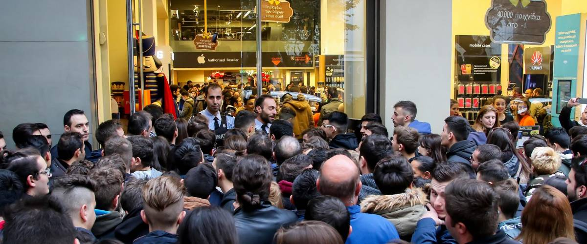 People wait outside a department store on Black Friday in Thessaloniki, Greece