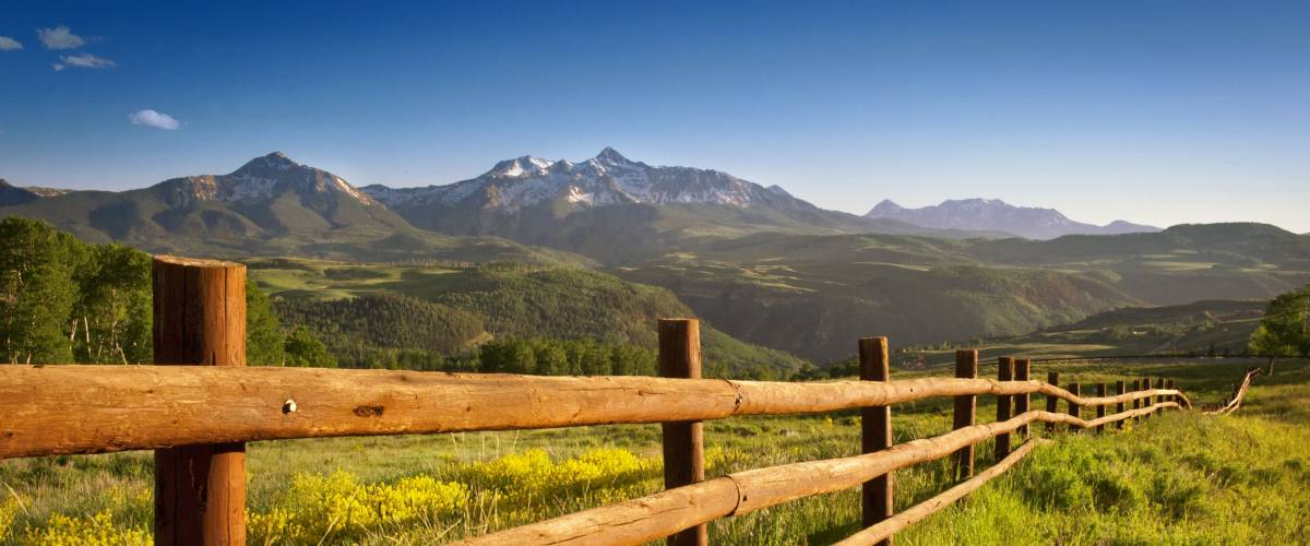 A ranch fence overlooking Mount Wilson, Colorado