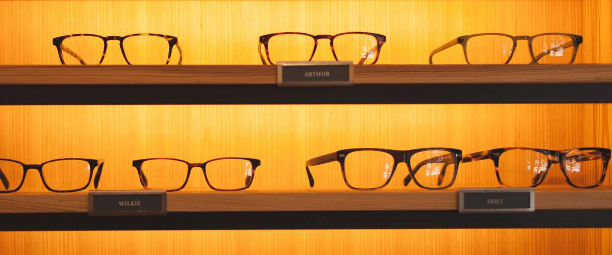 Display of stylish eyewear at Warby Parker store