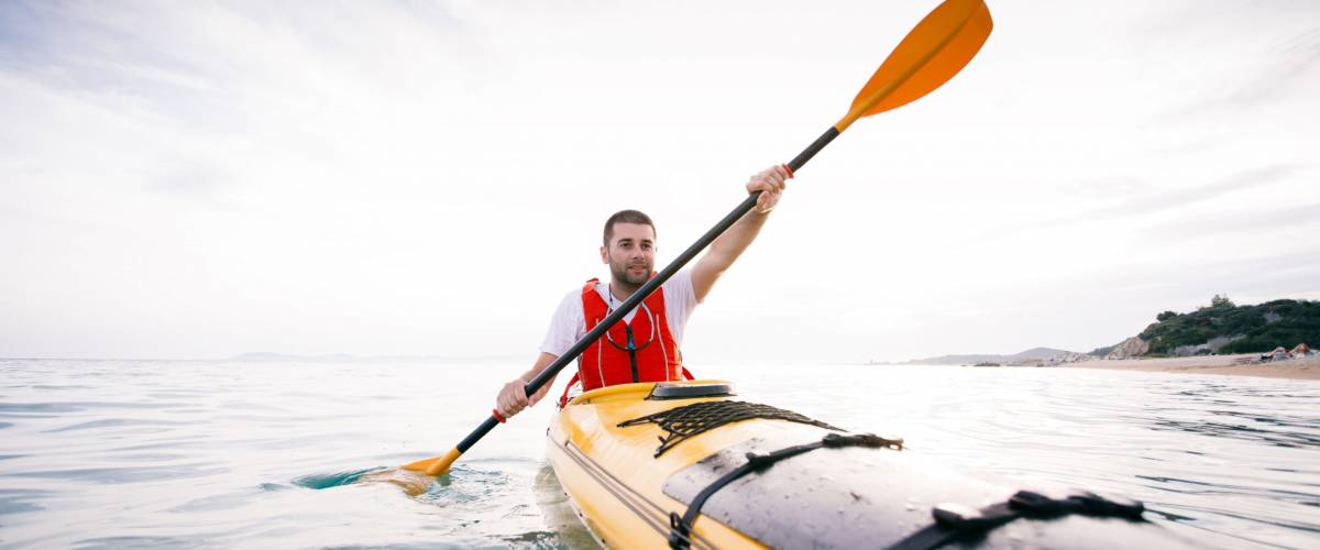 Kayaking. Man paddling a kayak. Concept for adventure, travel, action, lifestyle