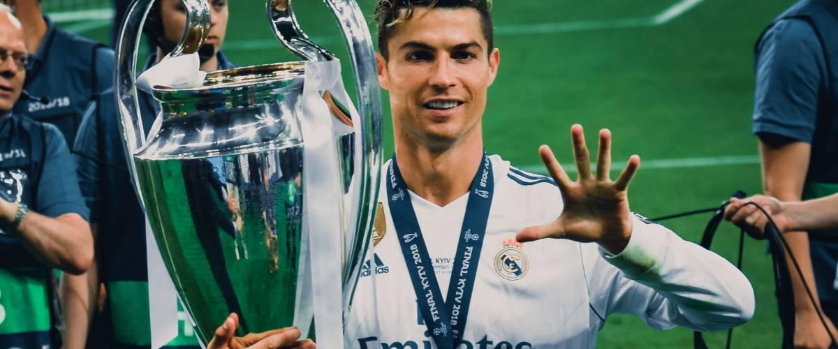 KYIV, UKRAINE - MAY 26, 2018: Cristiano Ronaldo shows on the fingers of his hand five won Champions League cups in Kiev, Ukraine