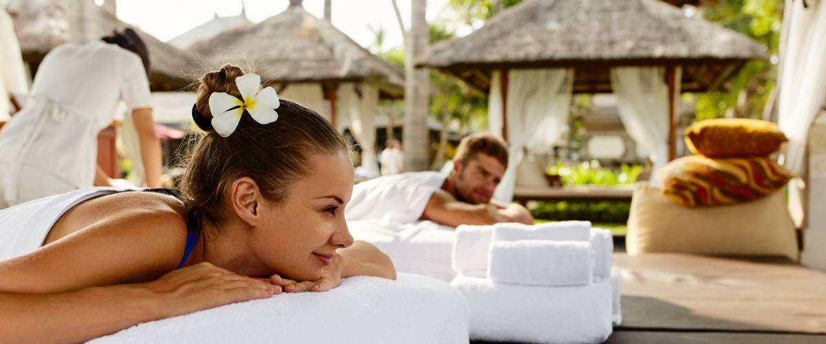 Romantic Couple Spa. Closeup Of Beautiful Healthy Happy Smiling Woman, Handsome Man Relaxing At Day Spa Resort.