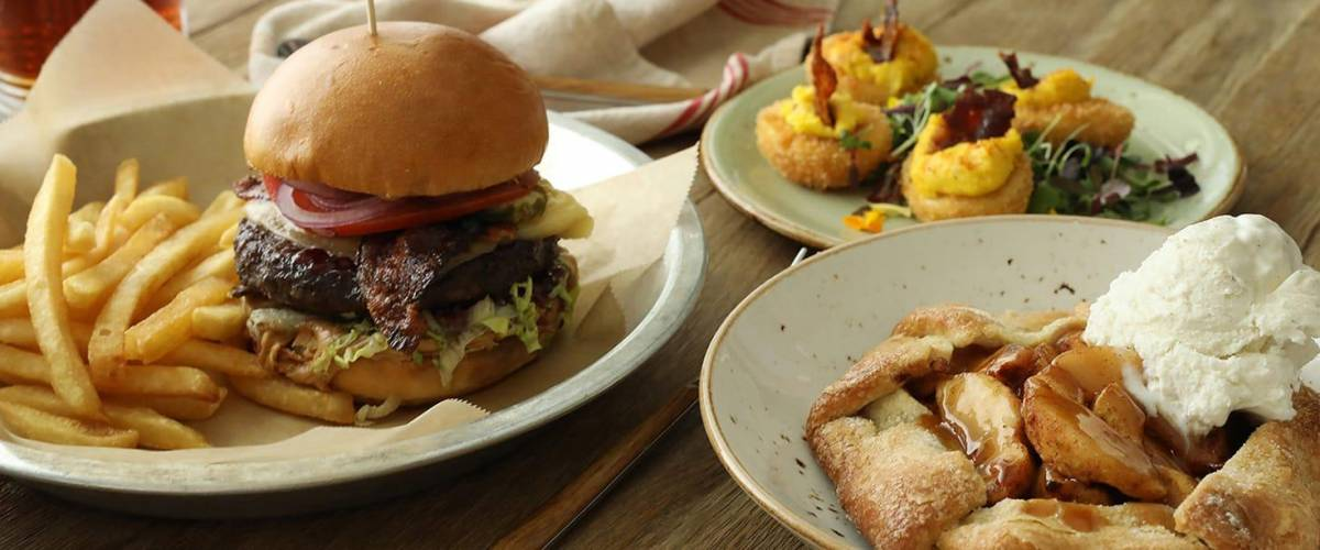 A burger, crispy deviled eggs and apple pie at a lazy dog location