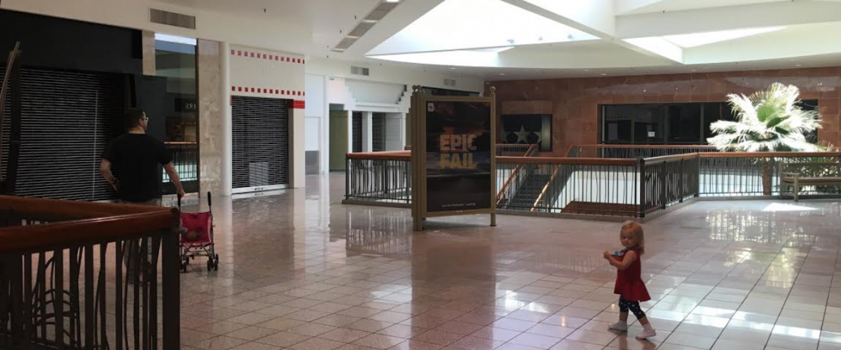 Mall visitors mill inside the nearly vacant wing of Fiesta that Macy's department store once anchored. Vacancy rates hit unprecedented highs after the 2008 recession.