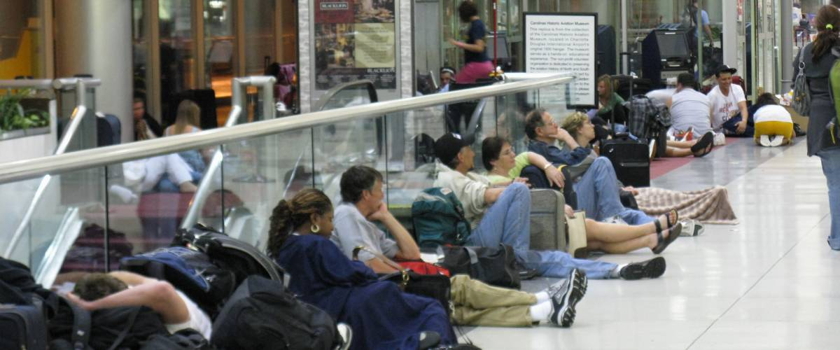 Travelers waiting overnight due to cancelled flights at Charlotte Douglas International Airport