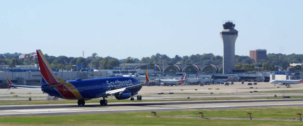 A plane lands at the sprawling Lambert-St. Louis International Airport