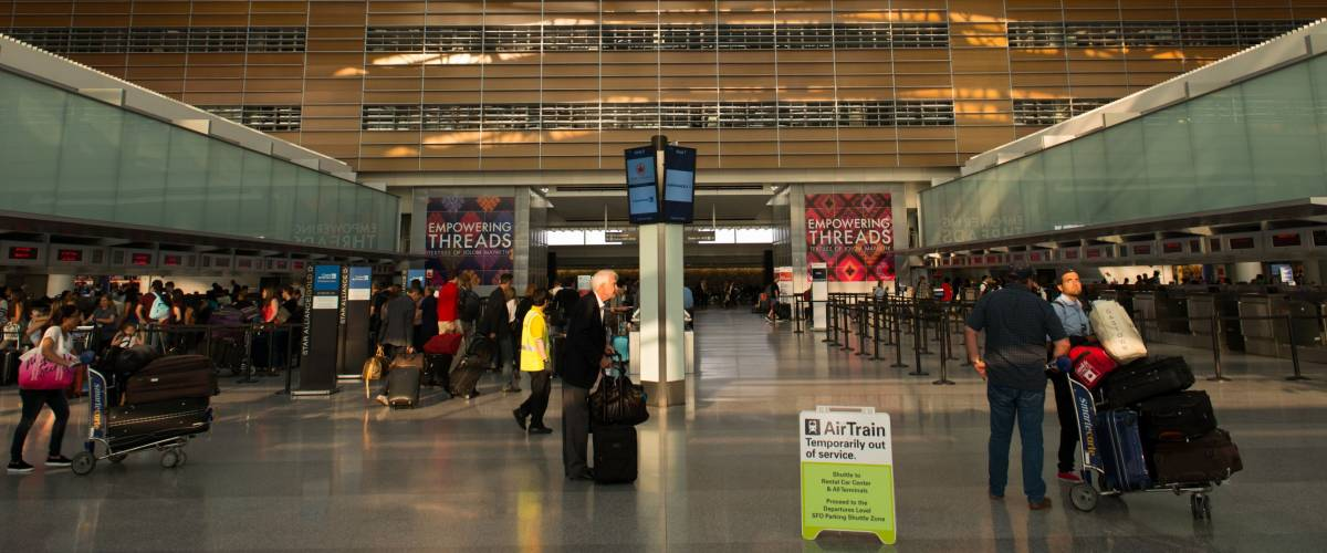 Full check-in counters and Air Train out of service at San Francisco International Airport.