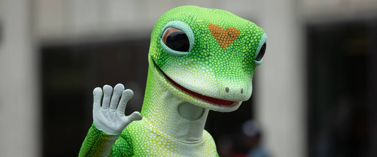 Indianapolis, Indiana, USA - September 22, 2018: The Circle City Classic Parade, Man wearing the Geico Gecko insurance mascot outfit