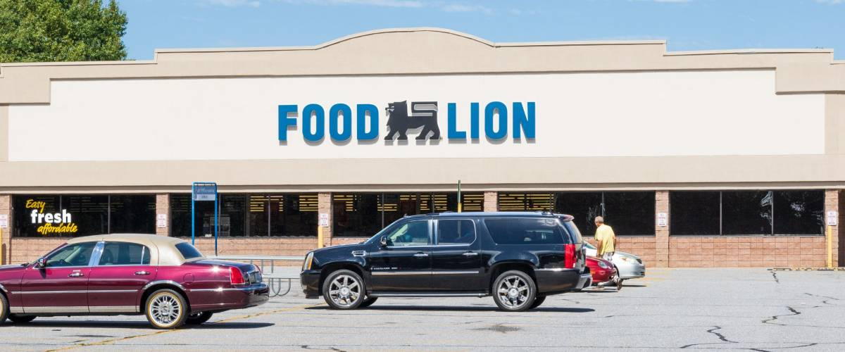 HICKORY, NORTH CAROLINA, USA-9/18/18: Building and sign of Food Lion Grocery supermarket, with one man in parking lot.
