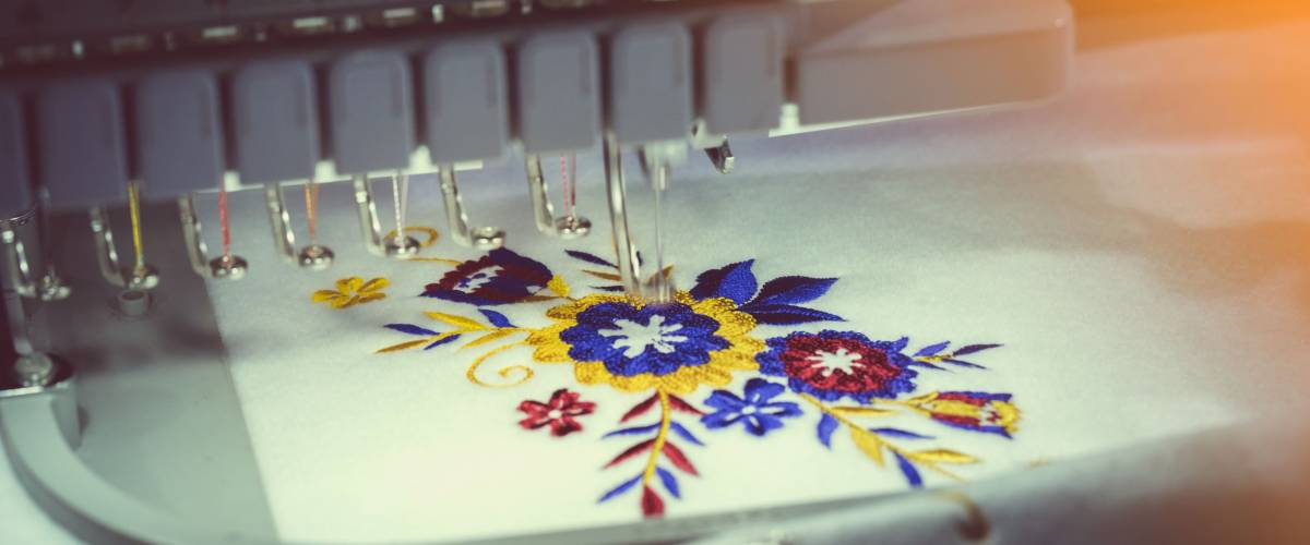 A computerized embroidery machine at work.