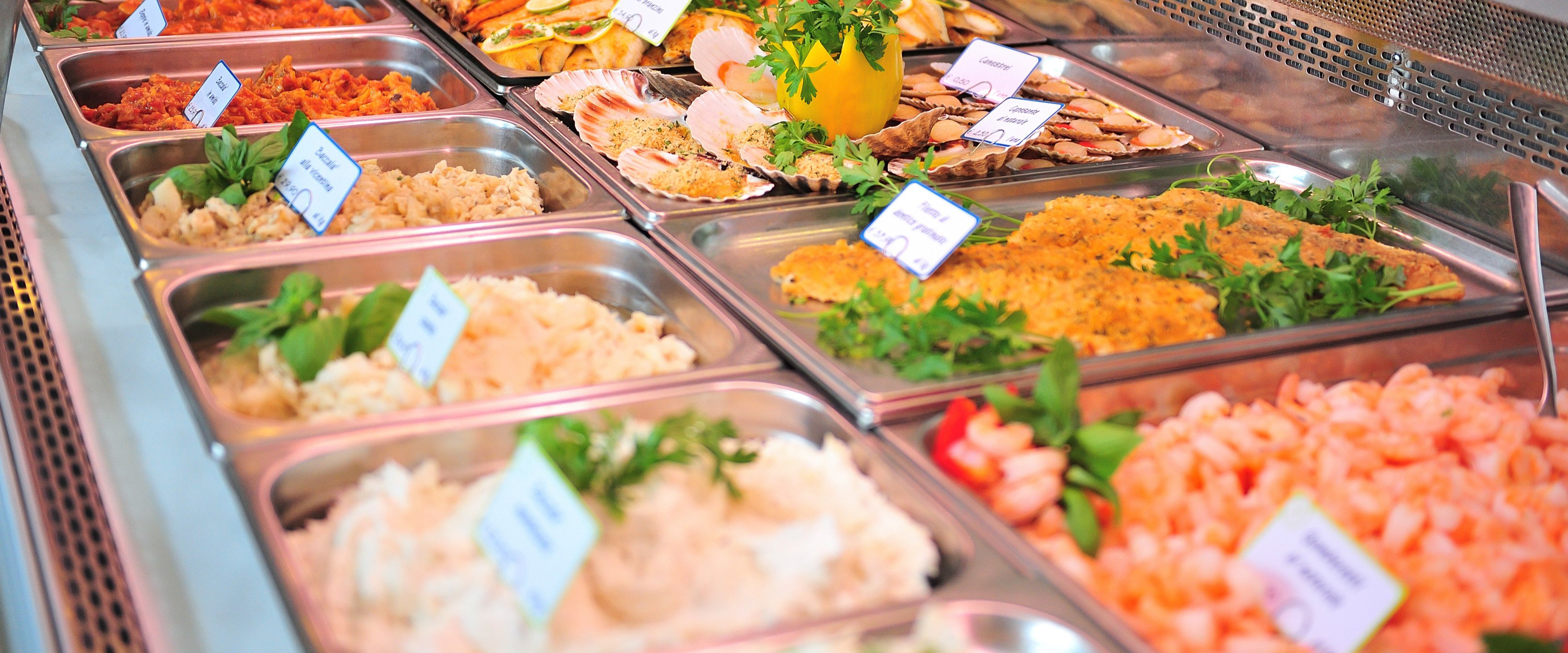 Expensive prepared foods in a lunch counter at a grocery store