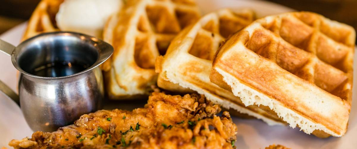 Fried chicken and waffles with syrup.