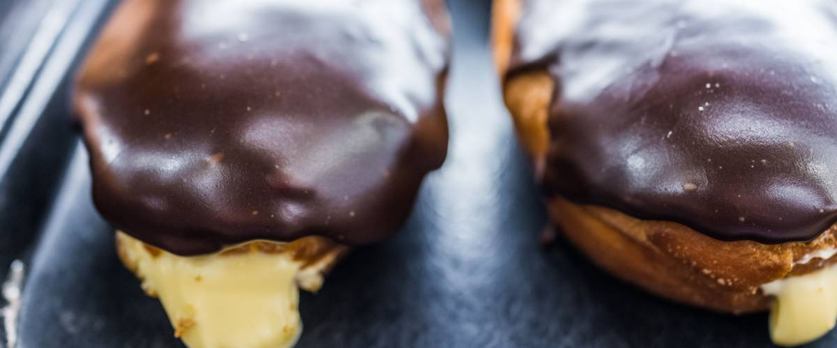 Boston cream donuts with filling oozing out