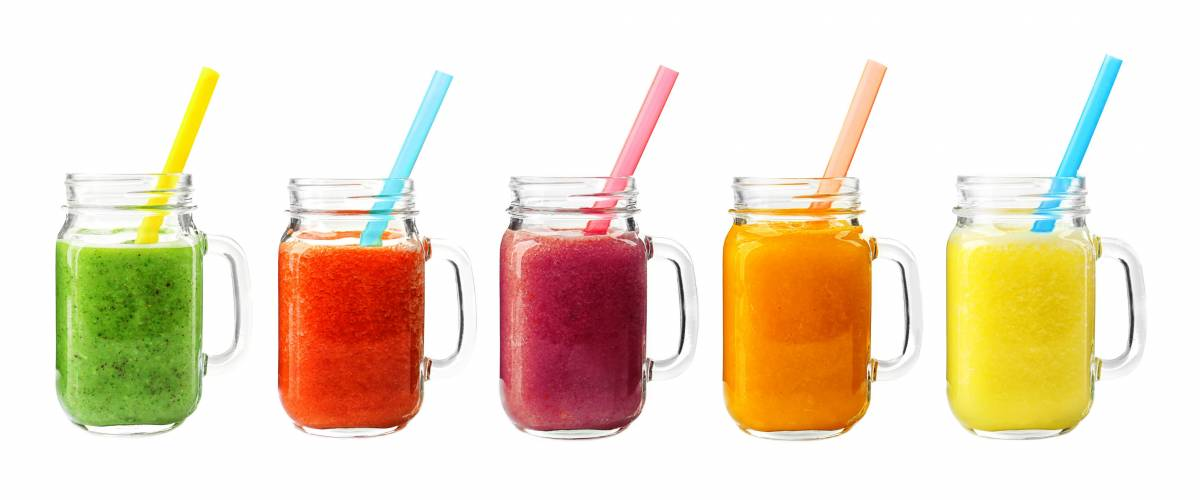 Collage of glass jars with fresh delicious smoothie and straw on white background.