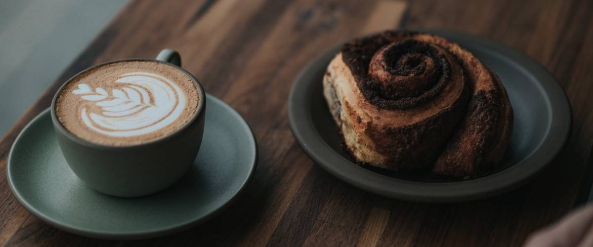 Latte and a cinnamon roll.
