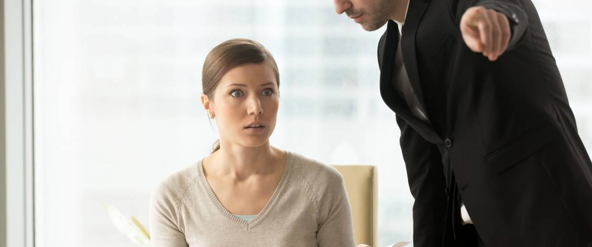 Executive manager giving written dismiss order to shocked female employee