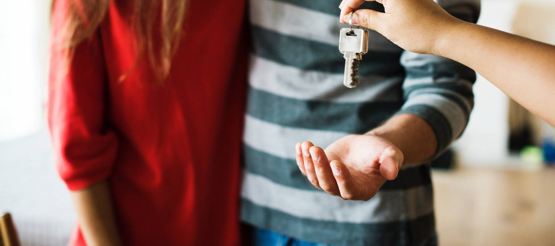 Couple taking the keys to a house
