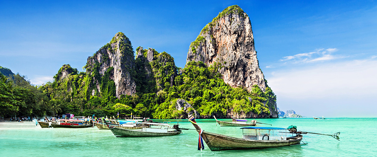 Longtail boats at a beautiful beach in Thailand