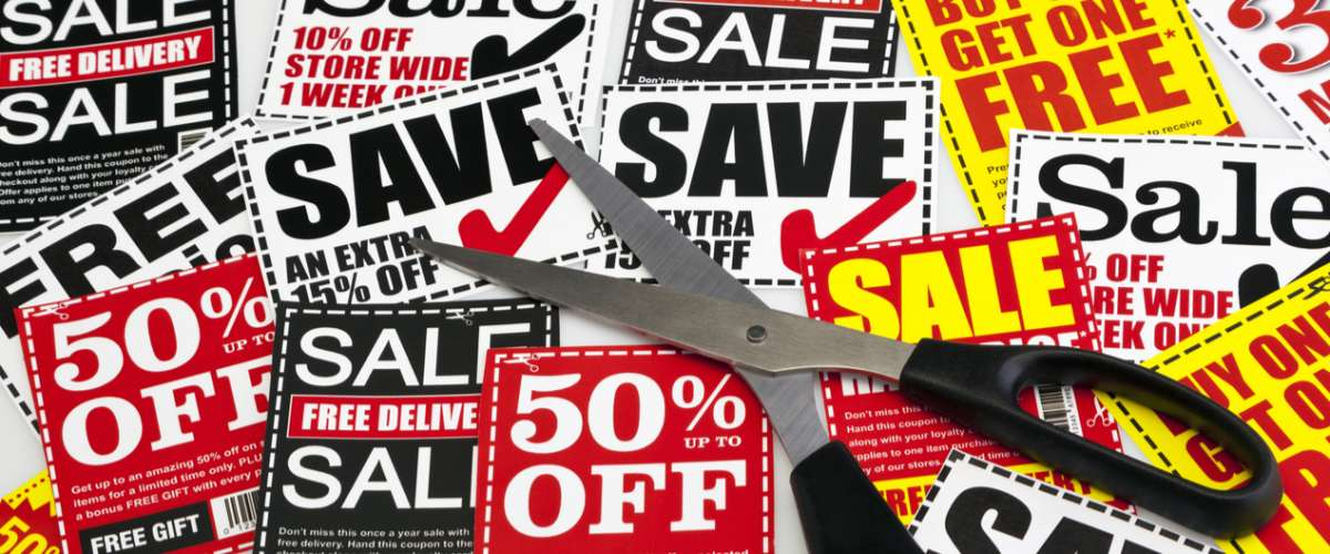 coupons for savings and scissors