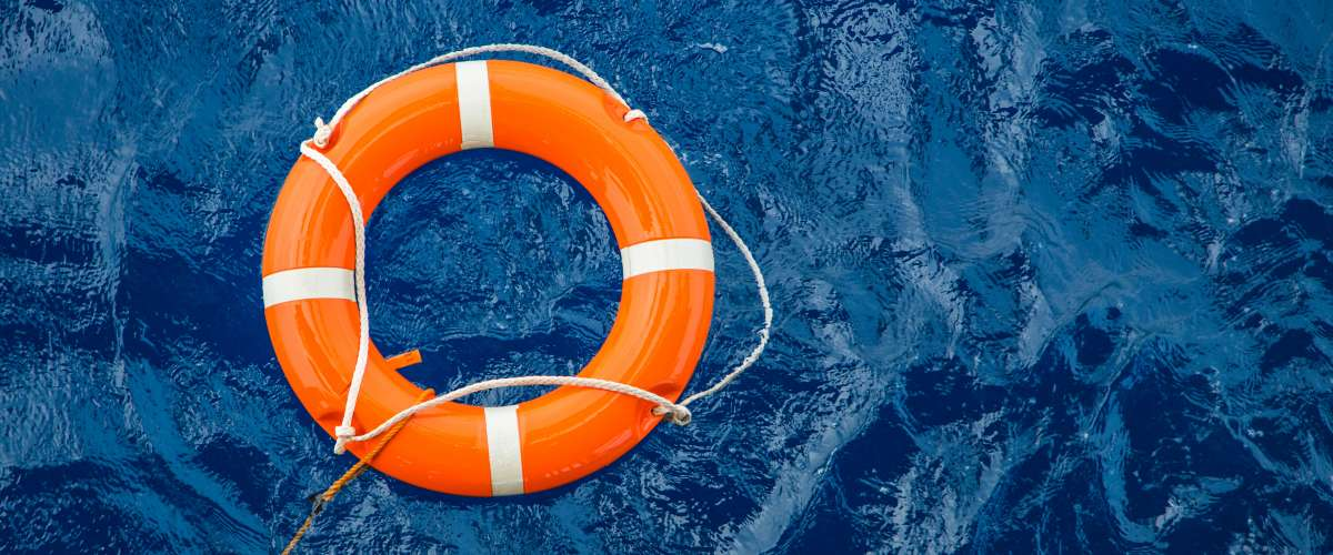 Life buoy preserver floating in water