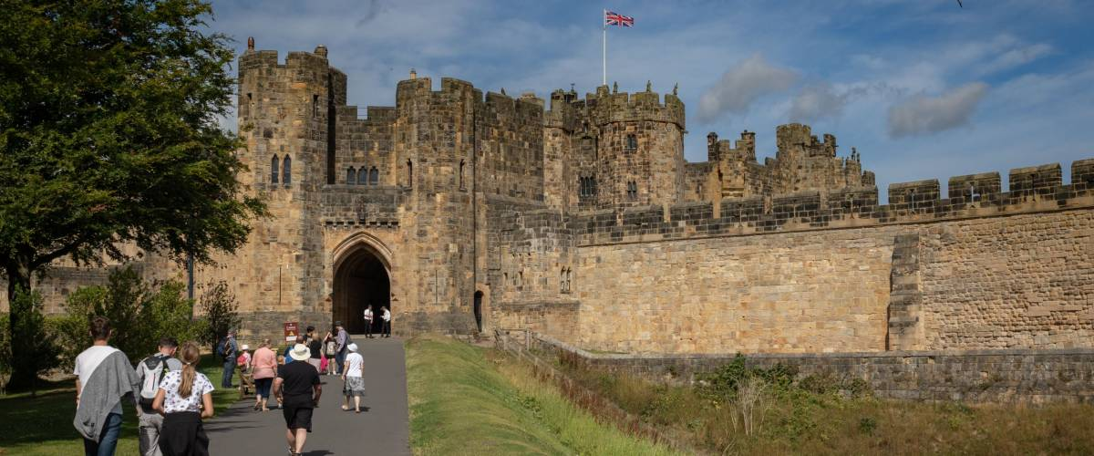 Alnwick, UK - July 31, 2018: Alnwick Castle - the seat of the Duke of Northumberland, the second largest inhabited castle in England. The castle is open to the public throughout the summer