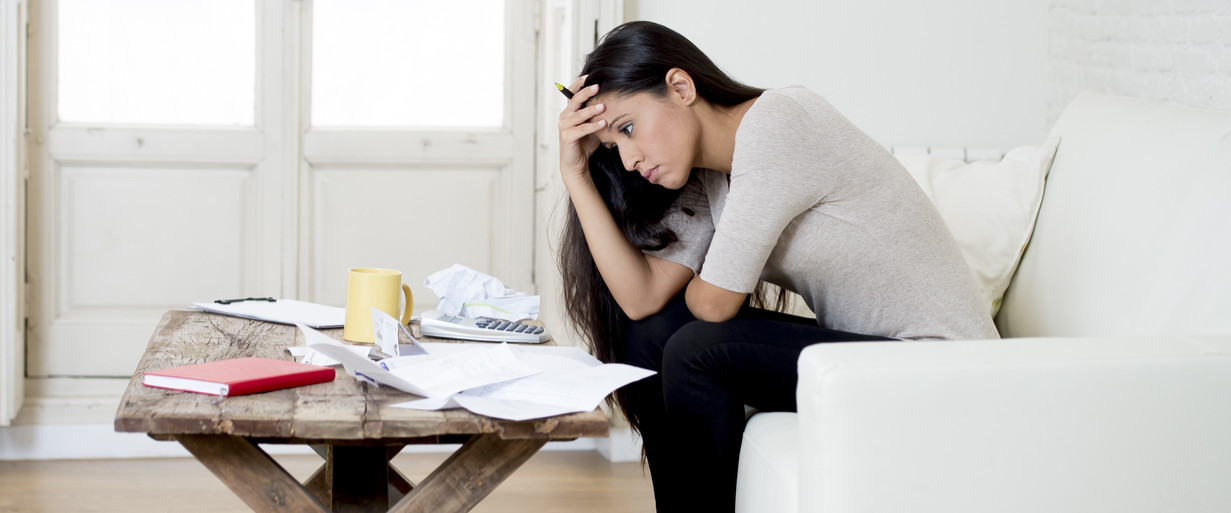 Young woman stressed about paying debt