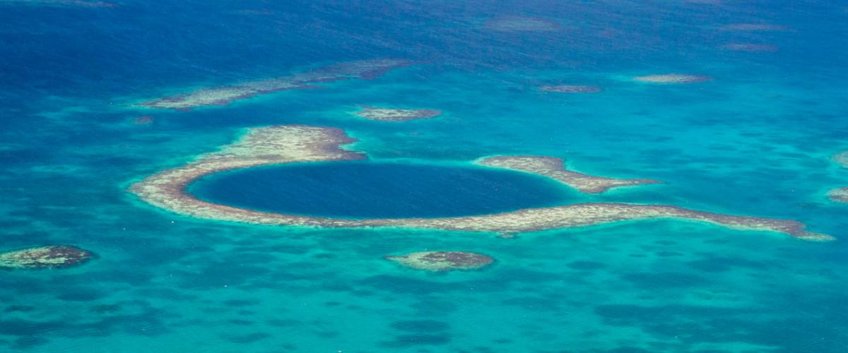 Aerial view of the great blue hole of the coast of Belize.