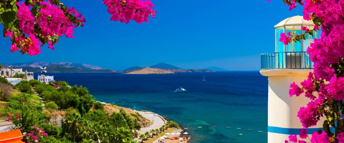 Bougainvillea frames a view across a bay in Ortakent near Bodrum, Turkey