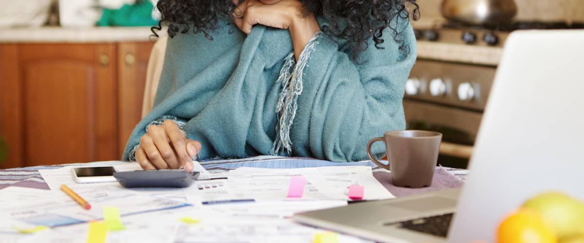 a young woman looks through her finances