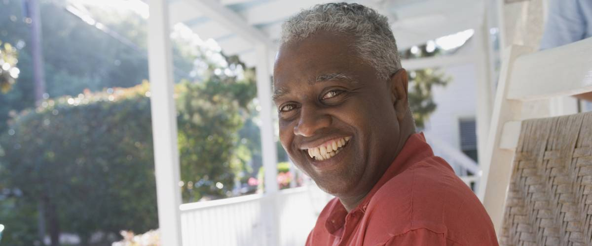 man sitting on porch retired