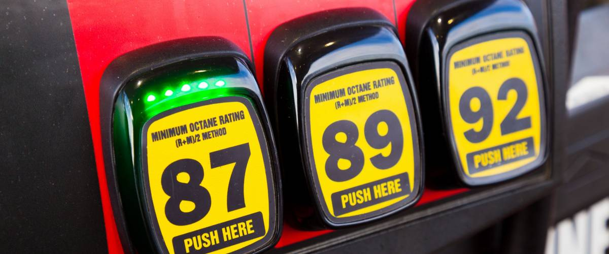 At a gas station multiple options are available for the type of gas to put in your vehicle and in this scenario the cheapest type of regular is selected since gas prices are rising and high.