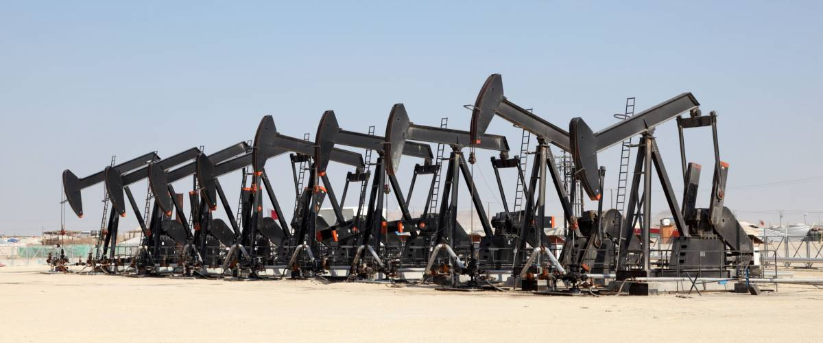 Black oil pump jacks in the desert of Bahrain