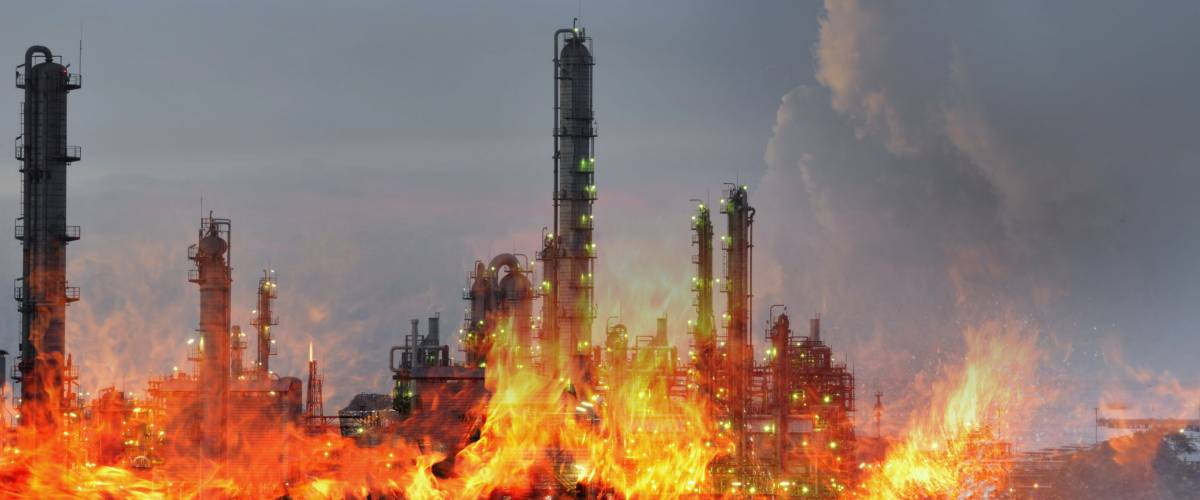Double exposure of Fire and refinery plant , concept crisis a large oil refinery fire and emergency fire case.