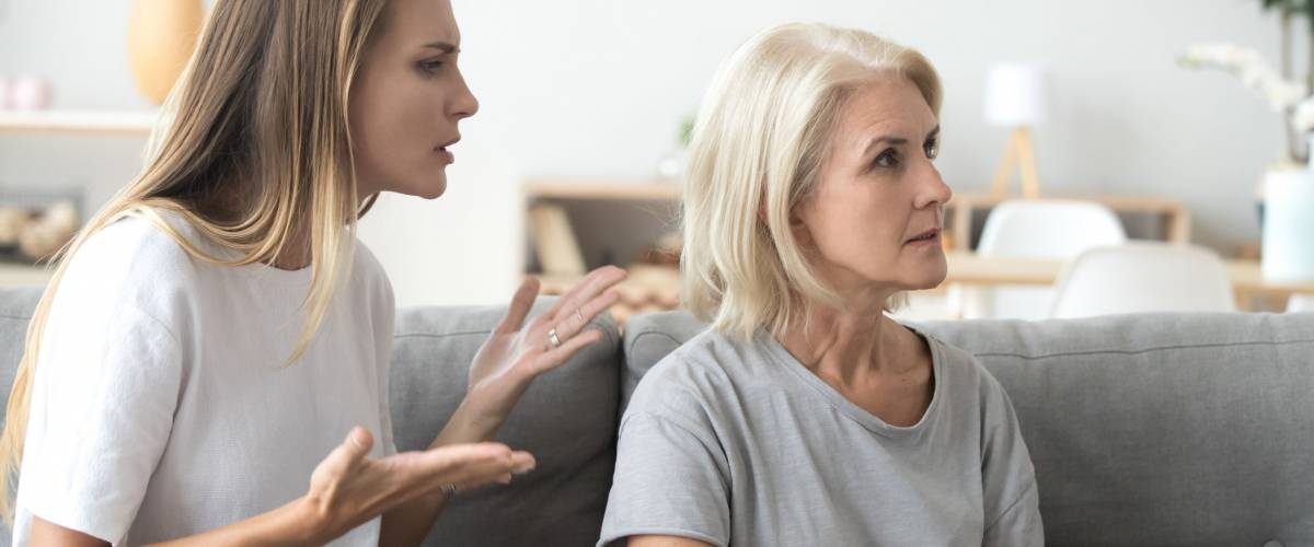 Annoyed adult daughter arguing with stubborn old senior mother-in-law