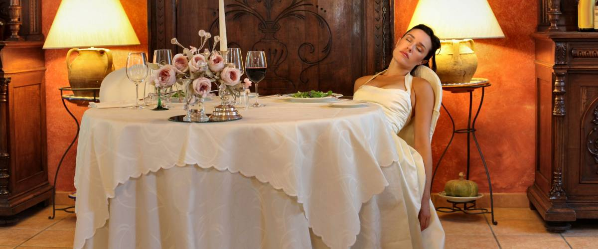 Bride sleeping at table in a luxury restaurant