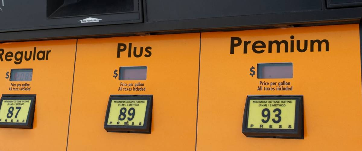Gas pump with color scheme altered to protect vendor's trademark.