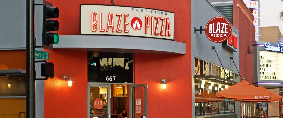 PASADENA/CALIFORNIA - FEB. 12, 2017: Building facade of the popular Blaze Pizza restaurant. Image was captured after sunset in Pasadena, California USA