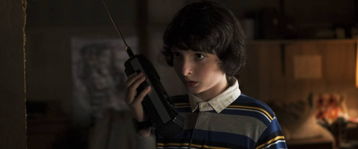 Jon from Stranger Things with Pentax camera