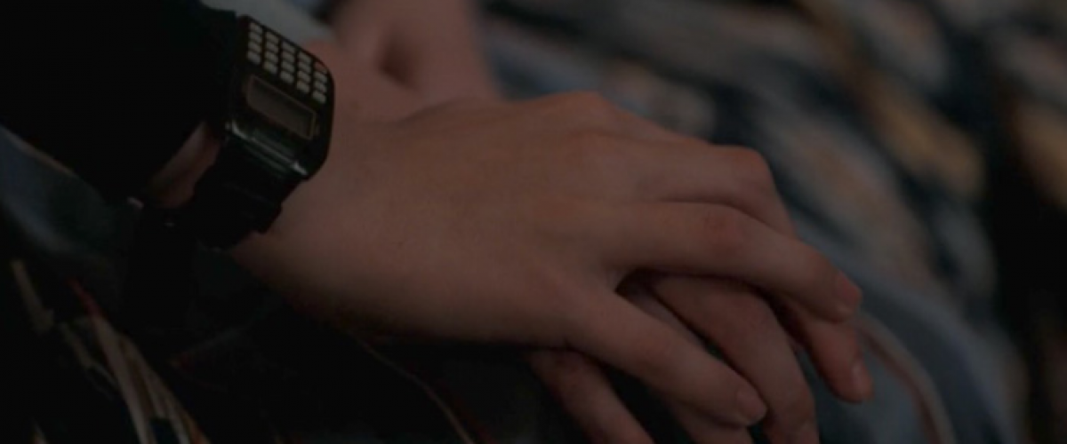 hand with a casio calculator watch