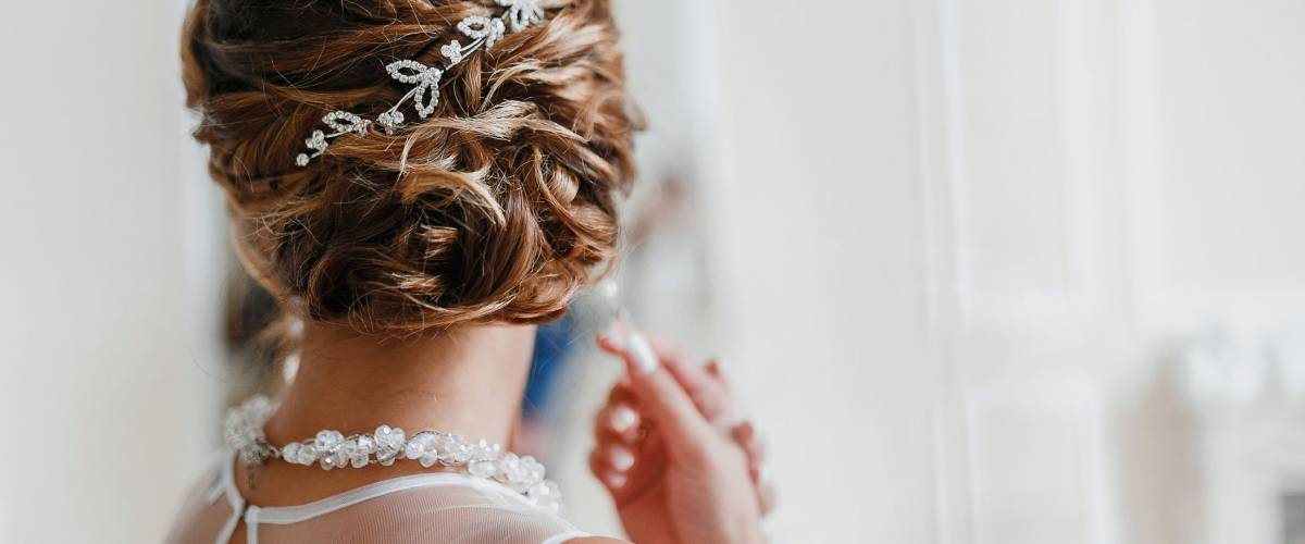 Bridal wedding hairstyle with jewelry wreath