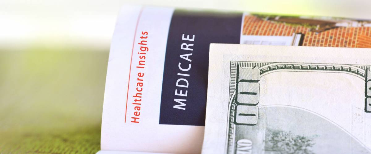 Medicare paper headline with  hundred dollar bill