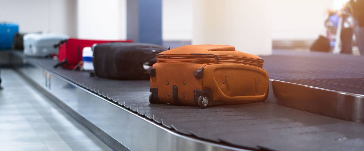 luggage bags on a carousel at airport