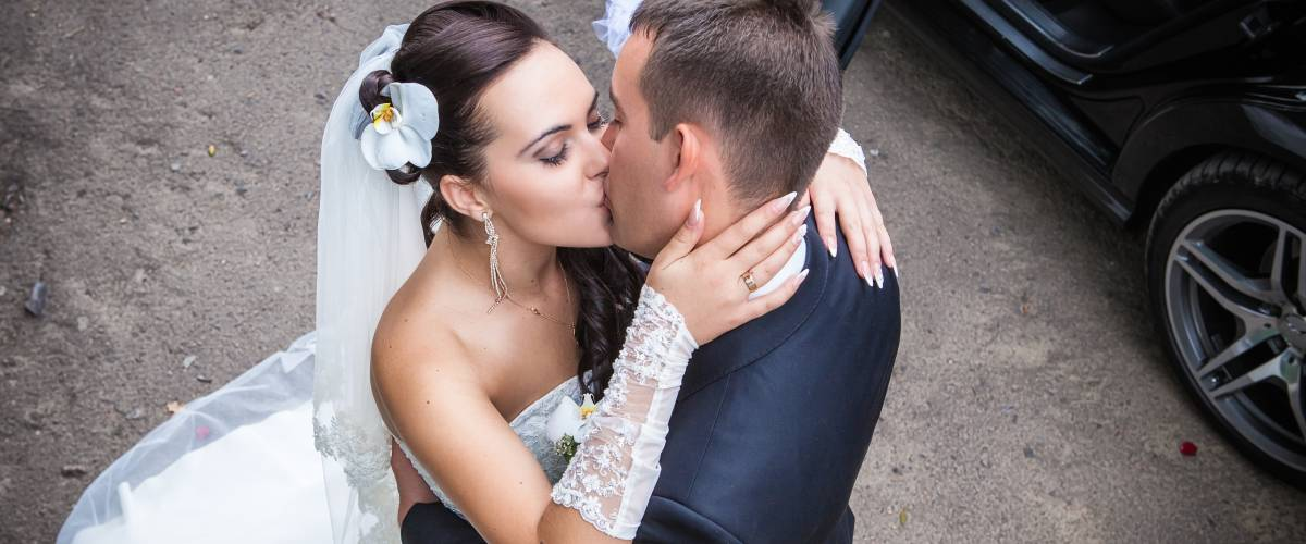 bride and groom kissing aerial view