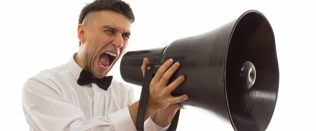 groom shouting into massive novelty megaphone